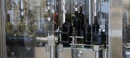 cooper-james-wine-bottles-running-thru-the-bottler