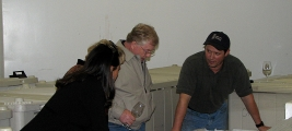 jim-kummer-cynthia-kummer-checking-out-the-fermenting-grapes-with-kian